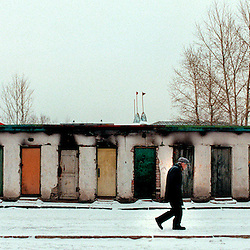 One of the coldest countries in the world, Mongolia's ground is covered with permafrost for 6 months of the year.  Here, a man walks by storage units in the capital.
