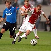 NLD/Amsterdam/20060823 - Ajax - FC Kopenhagen, Wesley Sneijder in duel met Tobias Linderoth
