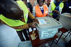30 /07/2018:Harare Zimbabwe. Polling officers and observers making sure the ballot boxes are sealed and empty at Zengeza 3 high school at Chitungwiza outside Harare before the voting station opened.773<br /> Picture: Matthews Baloyi/AFrican News Agency (ANA)