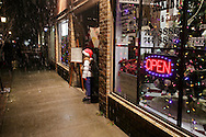 Pine Bush, NY - A girl walks out of a store and into the snow during the Pine Bush Festival of Lights on Dec. 5, 2009.