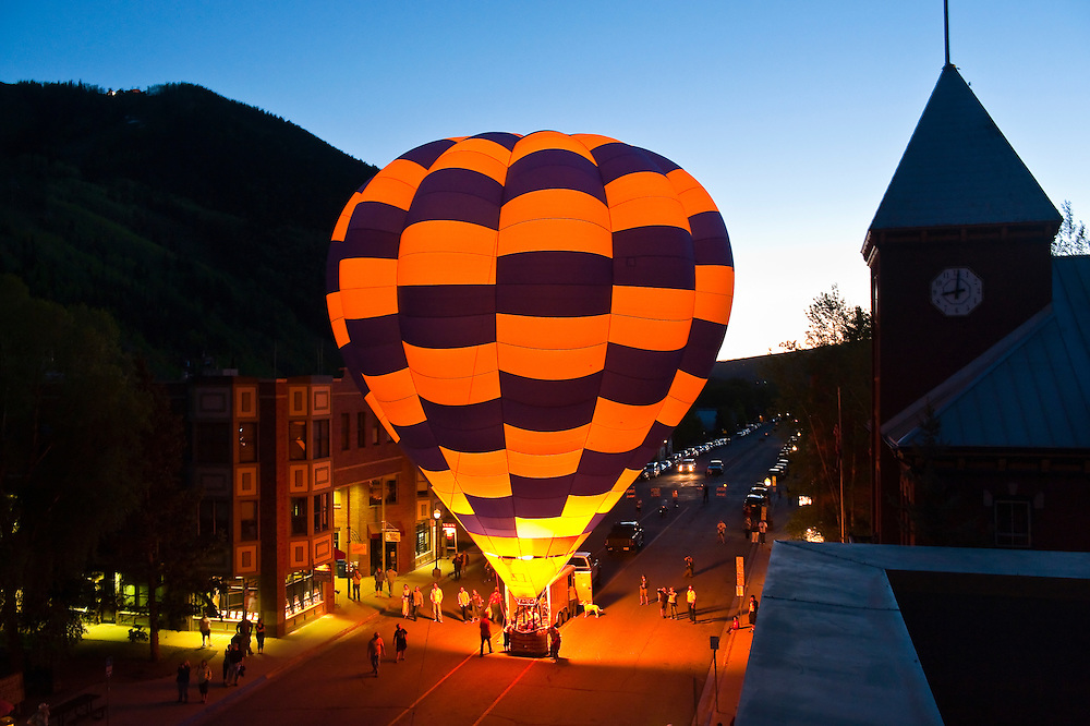Hot air balloons illuminated at night by their propane burners, Telluride Balloon Festival, Main Street, Telluride, Colorado USA