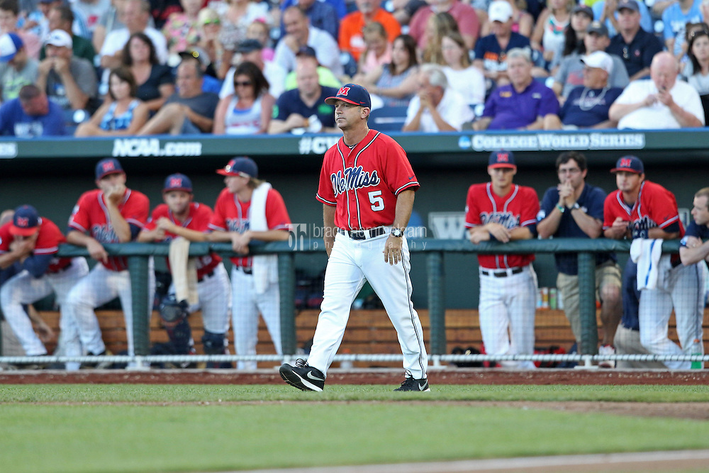 Head coach Mike Bianco #5 of the Ole Miss Rebels looks on during Game 4 of the 2014 Men's College World Series between the Virginia Cavaliers and Ole Miss Rebels at TD Ameritrade Park on June 15, 2014 in Omaha, Nebraska. (Brace Hemmelgarn)
