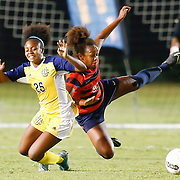 UC Irvin player collides with  Cal State Fullerton player Tala Haddad (26) while attempting to steal ball.<br /> <br /> Photo by Ozzy Jaime, Sports Shooter Academy