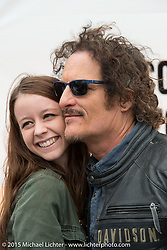 "Actor Kim Coates known for his roll as ""Tig"" on the Sons of Anarchy TV series poses with Kaitlyn Frizzell of Gainsville, GA during an autograph signing session at the Harley-Davidson display at Daytona International Speedway on the first day of Daytona Beach Bike Week 2015. FL, USA. Saturday, March 7, 2015.  Photography ©2015 Michael Lichter."