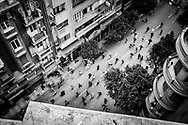View from a rooftop on Mahmoud Bassiouny, a street beside Talaat Harb Square, of anti-government demonstrators charging pro-government supporters during street fighting around Tahrir Square on February 3, 2011.