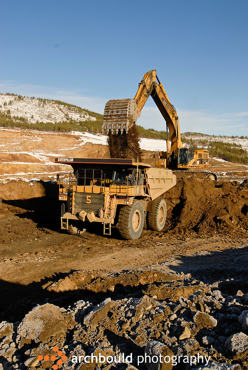 Heavy equipment working at Minto Mine, Yukon.<br /> <br /> NOT IN YOUR BUDGET? Contact Cathie for a price specific to your project.