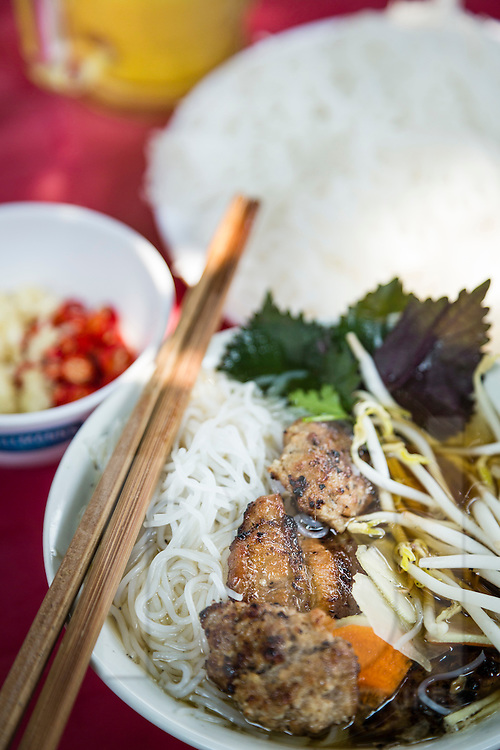 Famous street food bowl of bun cha served in a local restaurant of Hanoi, Vietnam, Southeast Asia