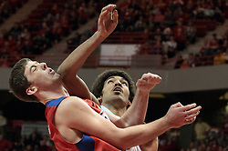 07 December 2013:  Reggie Lynch gets an elbow on the chin of Matt Kavanaugh as the two work to get rebound position during an NCAA mens basketball game. The Illinois State Redbirds beat the 25th ranked Dayton Flyers 81-75 in Redbird Arena, Normal IL
