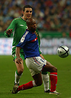 Photo. Daniel Hambury.<br /> FIFA World Cup 2006 Qualifier.<br /> France V Republic of Ireland. 09/10/2004.<br /> France's Sylvian Wiltord and Ireland's John O'Shea