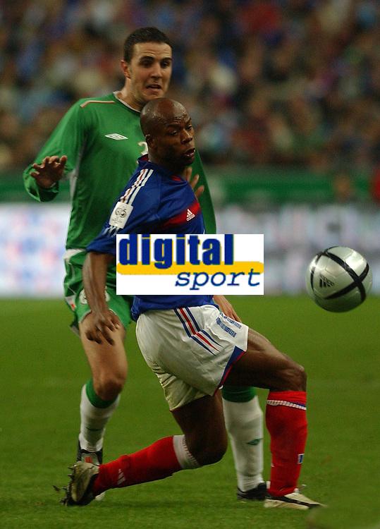 Photo. Daniel Hambury.<br /> FIFA World Cup 2006 Qualifier.<br /> France V Republic of Ireland. 09/10/2004.<br /> France's Sylvian Wiltord and Ireland's John O'Shea
