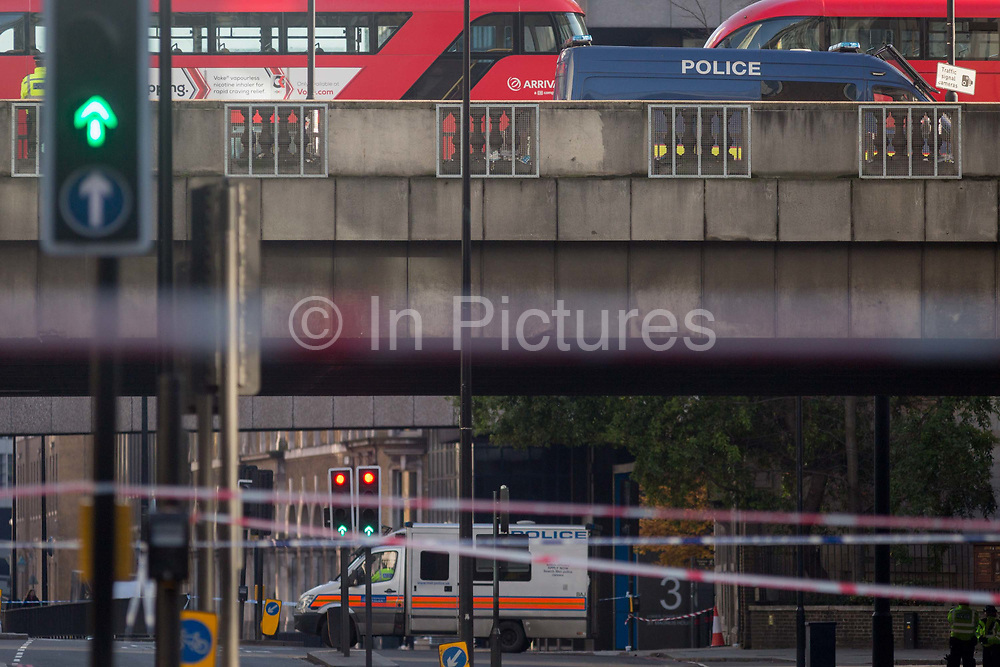 The morning after the terrorist attack at Fishmongers Hall on London Bridge, in which Usman Khan a convicted, freed terrorist killed 2 during a knife a attack, then subsequently tackled by passers-by and shot by armed police - Upper Thames Street is still cordoned off, on 30th November 2019, in London, England.