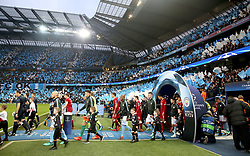 The two team's walk out before kick-off during the UEFA Champions League, Quarter Final at the Etihad Stadium, Manchester.