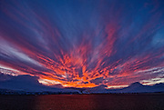 Vibrant red sunset clouds over  Antarctic Peninsula.