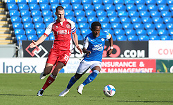 Siriki Dembele of Peterborough United in action with Paul Coutts of Fleetwood Town - Mandatory by-line: Joe Dent/JMP - 19/09/2020 - FOOTBALL - Weston Homes Stadium - Peterborough, England - Peterborough United v Fleetwood Town - Sky Bet League One