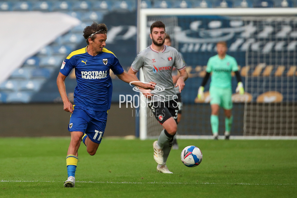 AFC Wimbledon midfielder Ethan Chislett (11) chasing through ball during the EFL Trophy Group O match between AFC Wimbledon and Charlton Athletic at the Kiyan Prince Foundation Stadium, London, England on 1 September 2020.