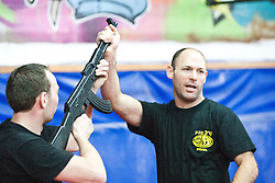 Amonon Drasa of the International Krav Maga Federation (IKMF), takes students on day two on the Train & Travel in Israel, on Saturday 1st Jan 2011, at the Olympic shooting academy. Train & Travel is a unique ten day program designed for IKMF's instructors, students & guests, interested in combining Krav Maga training with a tour of the holy land. Saturday 1st Jan 2011 at the Olympic shooting academy..©2011 Michael Schofield. All Rights Reserved.