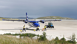 Barra Airport is a short-runway airport situated in the wide shallow bay of Traigh Mhòr at the north tip of the island of Barra in the Outer Hebrides, Scotland. Barra is now the only beach airport anywhere in the world to be used for scheduled airline services.Ground crew prepare for unloading and loading of aircraft. (c) Stephen Lawson | Edinburgh Elite media