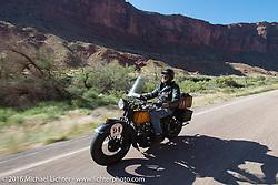 Rich Rau riding his 1936 Harley-Davidson R on Utah Highway 128 north of Moab during stage 11 (289 miles) of the Motorcycle Cannonball Cross-Country Endurance Run, which on this day ran from Grand Junction, CO to Springville, UT., USA. Tuesday, September 16, 2014.  Photography ©2014 Michael Lichter.