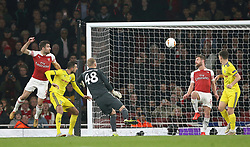 Arsenal's Sokratis Papastathopoulos (left) scores his side's third goal of the game