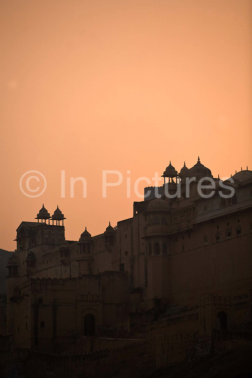 Sunset over the Amber Fort, Jaipur, India<br /> The Amer Fort, was built over the remnants of an earlier structure during the reign of Raja Man Singh, Commander in Chief of Akbar's army in 1592.The structure was expanded by his descendants, over the next 150 years