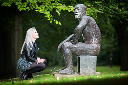 © Licensed to London News Pictures. 06/09/2017. Wakefield UK. Millie Carroll looks at the Elizabeth Frink sculpture 'Seated Man II' from 1986 that has been placed on display at the Yorkshire Sculpture Park as part of their 40th anniversary celebrations. The work illustrates Frink's appreciation of the male figure for it's potency & vulnerability. Photo credit: Andrew McCaren/LNP