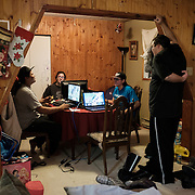 From left: Chad Henry, Steven Kabestra, Sammuel McDonald and Johnathan Beauchamp as they play the computer game Age of Empires at McDonald's home at the Ochiichagwe'Babigo'Ining Ojibway Nation reserve (also known as the Dalles First Nation) in Northern Ontario, Canada on 20 December 2016. As the Internet connectivity on the reserve does to permit them to play games online, they often network their computers together and play classic games that they grew up with, like Age of Empires. Henry is responsible for operations and maintenance tasks on the Nation's reserve. In 2013, together with a council of the community's youth, he initiated a project to erect a tower to bring broadband Internet access to the reserve. According to users it worked well in the beginning, but challenges have since arisen as a result of storm damage to equipment and growing demand.