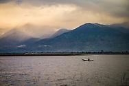 Tiny barge sails on Ho Lak (Lak lake), Dak Lak, Vietnam, Southeast Asia