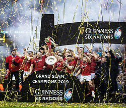 Wales celebrate the Grand Slam<br /> <br /> Photographer Simon King/Replay Images<br /> <br /> Six Nations Round 5 - Wales v Ireland - Saturday 16th March 2019 - Principality Stadium - Cardiff<br /> <br /> World Copyright © Replay Images . All rights reserved. info@replayimages.co.uk - http://replayimages.co.uk