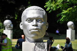 """© Licensed to London News Pictures. 05/07/2017. London, UK. """"Numen (Shifting Votive, One, Two, Three)"""", 2017, by Thomas J. Price.  The Frieze Sculpture festival opens to the public in Regent's Park.  Featuring outdoor works by leading artists from around the world the sculptures are on display from 5 July to 8 October 2017.  Photo credit : Stephen Chung/LNP"""