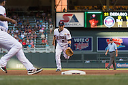 Brian Dozier #2 of the Minnesota Twins attempts to field a ground ball unsuccessfully during a game against the Kansas City Royals on June 27, 2013 at Target Field in Minneapolis, Minnesota.  The Twins defeated the Royals 3 to 1.  Photo by Ben Krause