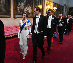 The Princess Royal and Jared Kushner arrive through the East Gallery during the State Banquet at Buckingham Palace, London, on day one of the US President's three day state visit to the UK.
