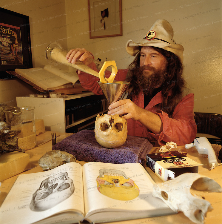 Bob Bakker pouring pasta into Cope's noodle for a volumetric reading of homo sapiens' brain size, to compare with that of our next of kin, Homo erectus, a species which had about a third less cranial capacity.
