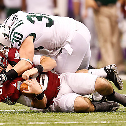 December 18, 2010; New Orleans, LA, USA; Troy Trojans quarterback Corey Robinson (6) is hit by Ohio Bobcats linebacker Erik Benjamin (30) as he slides during the first half of the 2010 New Orleans Bowl at the Louisiana Superdome.  Mandatory Credit: Derick E. Hingle