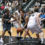 Efes Pilsen's Bootsy THORNTON (L) and Ender ARSLAN (C) during their Turkish Basketball league derby match Besiktas between Efes Pilsen at the BJK Akatlar Arena in Istanbul Turkey on Saturday 30 April 2011. Photo by TURKPIX