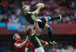 March 13, 2016 - Vancouver, BC, Canada - South Africa's Kwagga Smith, top, grabs the ball out of the air while being lifted by teammate Kyle Brown in front of Wales' Sam Cross, left, during World Rugby Sevens Series' Canada Sevens tournament action, in Vancouver, B.C., on Sunday March 13, 2016. THE CANADIAN PRESS/Darryl Dyck (Credit Image: © Darryl Dyck/The Canadian Press via ZUMA Press)