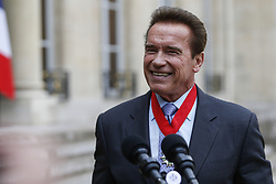 April 28, 2017 - Paris, France - US actor and former governor of California Arnold Schwarzenegger speaks to the press after he was awarded France's highest national order the 'Chevalier (Knight) de la Légion d'Honneur' by the president of France at the Elysee Palace in Paris, on April 28, 2017. (Credit Image: © Geoffroy Van Der Hasselt/NurPhoto via ZUMA Press)
