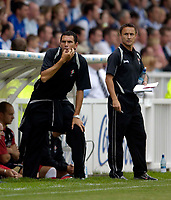 Photo: Jed Wee.<br />Hartlepool United v Swindon Town. Coca Cola League 2.<br />05/08/2006.<br /><br />Swindon assistant manager Gustavo Poyet (L) with manager Dennis Wise.