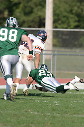 22 October 2005: Titan Tim Irvin makes a diving attempt at stopping Thunder Chaz Black. The Illinois Wesleyan Titans posted a 23 - 14 home win by squeeking past the Thunder of Wheaton College at Wilder Field (the 5th oldest collegiate field in the US) on the campus of Illinois Wesleyan University in Bloomington IL