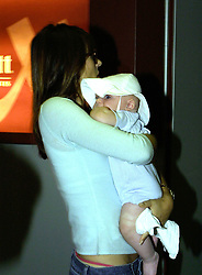 Liz Hurley and baby Damian arrive at Heathrow from New York by Concorde. Pap, half length, Elizabeth.