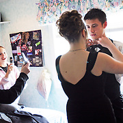 Nichole Delano, left, and Sarah York document the scene with their camera phones as Heather York helps Florian Maure, an exchange student from France, prepare for that uniquely American experience, namely, McKay High School's prom, April 21, 2007. THOMAS PATTERSON   Statesman Journal