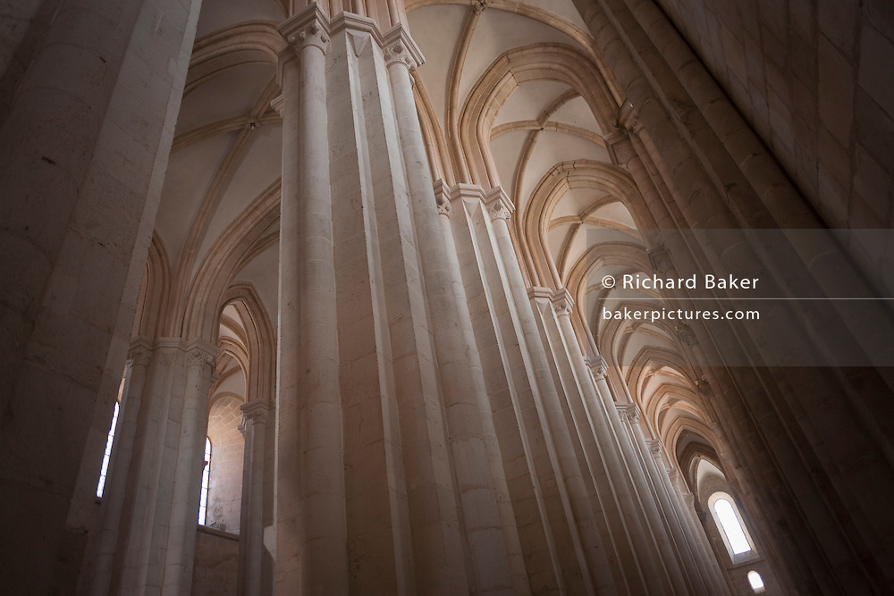 Plain nave and vaulted ceiling architecture of the Alcobaca Monastery, Portugal.