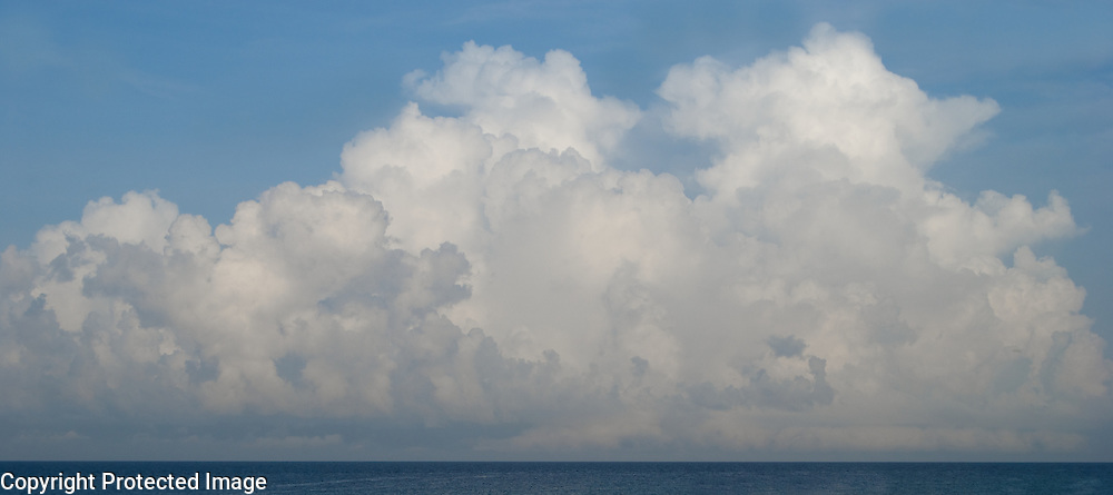 I'm awed by the gorgeous, massive ocean-fed clouds. This behemoth was over the Gulf of Mexico in Florida.
