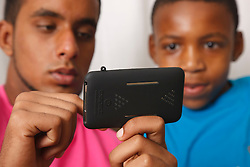 Teenagers playing games on an iphone