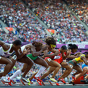 Carmelita Jeter of the United States, center, (6), won her semifinal heat in the women's 100m at Olympic Stadium during the 2012 Summer Olympic Games in London, England, Saturday, August 4, 2012. (David Eulitt/Kansas City Star/MCT)