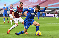 Football - 2020 / 2021 Premier League - West Ham United vs Brighton & Hove Albion - London Stadium<br /> <br /> Brighton & Hove Albion's Solly March holds off the challenge from West Ham United's Vladimir Coufal.<br /> <br /> COLORSPORT/ASHLEY WESTERN