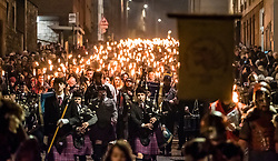 Edinburgh, Scotland,United Kingdom. 30 December, 2017.  Torchlight Procession which forms one part of Edinburgh's Hogmanay celebrations. pIctured; Procession passes down The Royal Mile towards Holyrood Palace.