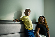 BIRMINGHAM, AL – SEPTEMBER 25, 2019: Antionette Pruitt, 29, with her 4-year-old son, Axtyn Taylor in their apartment.