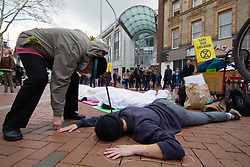 Extinction Rebellion protest in Reading, they held a two hour demonstration linking death rates to climate change. UK 2 March 2019
