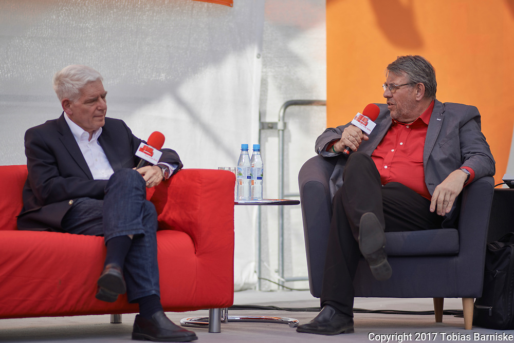 """Dr. Josef Schuster (left), President of the Central Council of Jews in Germany, talking about the relationship between Jews, Christians and Muslims in Germany today with Arnd Brunner (right), head of christian magazine """"Chrismon""""."""