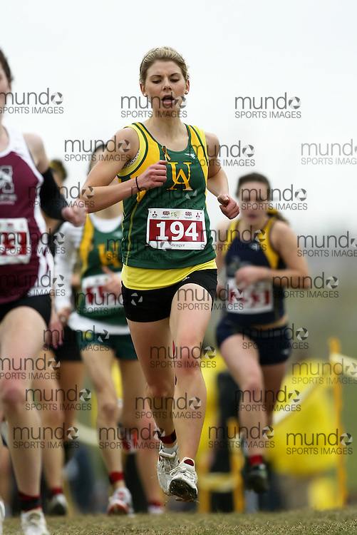 (Kingston, Ontario -- 14 Nov 2009)  JOELLE STENGER of the University of Alberta runs to 51 place at the  2009 Canadian Interuniversity Sport CIS Cross Country Championships at Forth Henry Hill in Kingston Ontario. Photograph copyright Sean Burges / Mundo Sport Images, 2009.